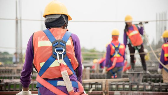 Scaffolders wearing safety harnesses